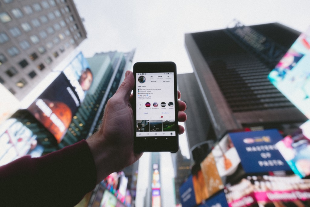 Instagram on a phone in a city